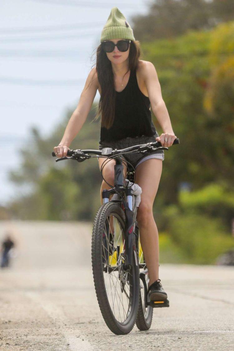 Dakota Johnson Riding A Bicycle In Malibu
